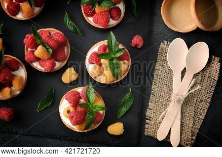 Delicious Summer Tartlets With Raspberries And Yoghurt. Yellow And Red Raspberries. Healthy Dessert.