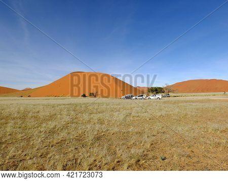 Sossusvlei, Namibia - 02 May 2012: Cars In Dunes In Namib Desert, Sossusvlei, Namibia