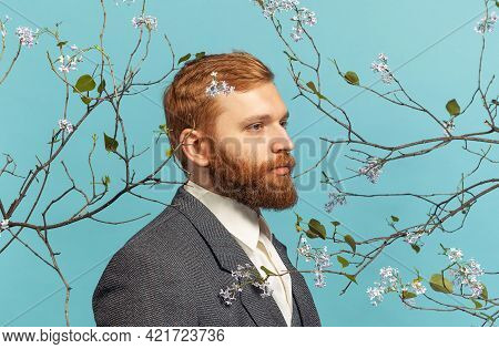 Close-up Portrait Of Young Red Headed And Bearded Man Acting Famous Artist Isolated Over Blue Floral