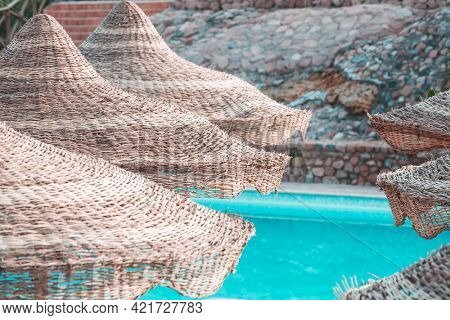 Beach parasols by the pool. Vacation concept