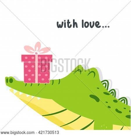 Сute Crocodile Holds A Gift Box With A Bow On His Nose. Greeting Card Template With Lettering With L
