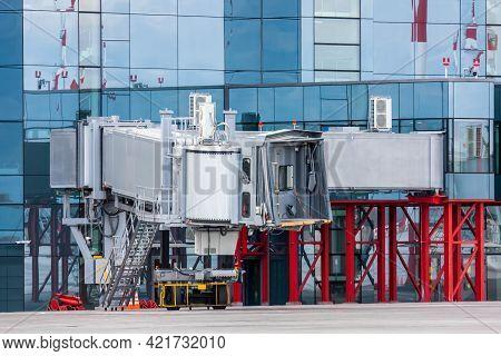 Empty Passenger Air Bridge At Airport Apron