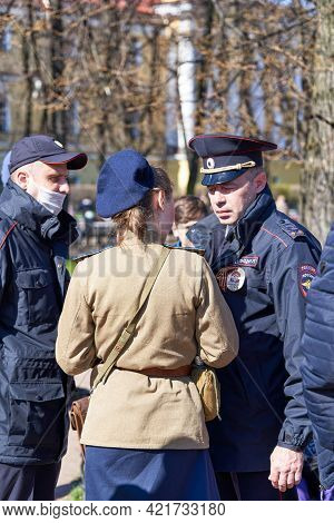 Police Detain A Woman In Military Uniform On The Street Of St. Petersburg