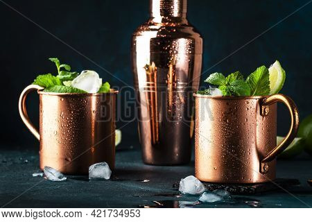 Moscow Mule Alcoholic Cocktail In Copper Mug With Lime, Ginger Beer, Vodka And Mint. Blue Table, Cop