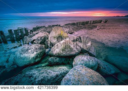 Big Rocky Stones In Dutch Lake At Twilight In The Early Morning