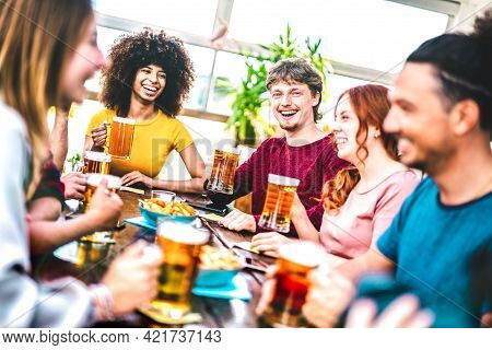 Young People Toasting Beer At Brewery Bar Rooftop - Friendship Life Style Concept With Young Milenia