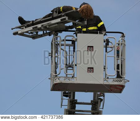 Basket Of The Aerial Platform During The Rescue Maneuver Of An Injured Person With A Mobile Stretche