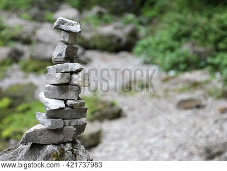 High Stack Of Rocks In The Mountains Called By Cairn Climbers Or Small Man Symbol Of Prayer Or To In