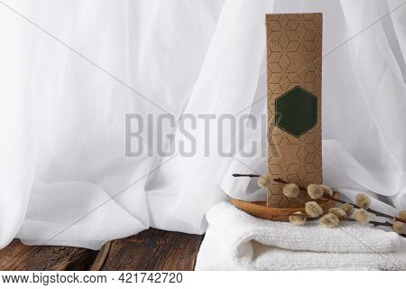 Scented Sachet, Pussy Willow Branches And Towel On Wooden Table, Space For Text
