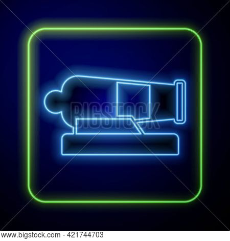 Glowing Neon Cannon Icon Isolated On Blue Background. Vector