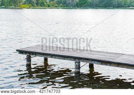Empty Wooden And Metallic Pier On The Water Near Green Park. Spring. Light. Nature. Beach. Leisure.