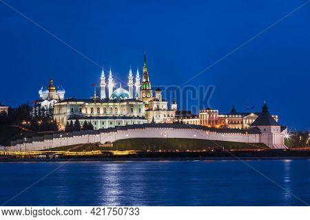 Illuminated Kazan Kremlin, a UNESCO World Heritage Site and historic citadel of Tatarstan, Russia, as viewed across the Kazanka river at night