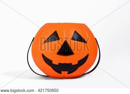 Jack O Lantern Orange Basket Or Bucket For Sweets Isolated On White Background With Shadow. Hallowee