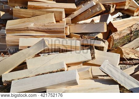 A Pile Of Wood, Chopped For Burning In The Oven.preparing For Winter. A Pile Of Logs For Firewood. B