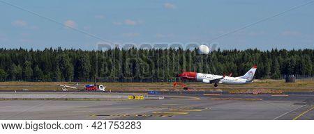 Panoramic view. Air hot blur.Oslo Gardermoen International Airport. The airport has biggest passenger flow in Norway.July 3,2018. Oslo,Norway