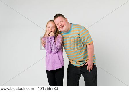 Cute siblings with down syndrome