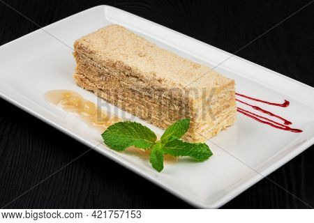 Esterhazy traditional cake with mint on black wooden background