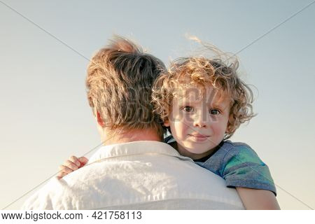 Happy Family. Father And Son Hugging Outdoors. Dad With His Cute Child Walking Outdoor Adorable Curl