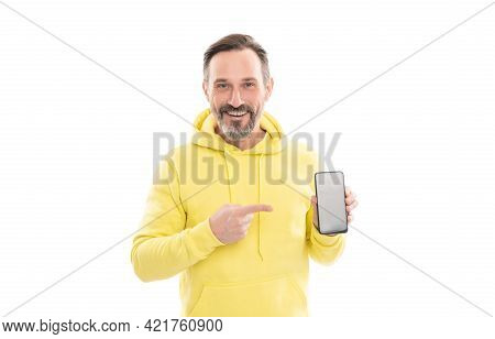 Happy Man Presenting Smartphone Screen Pointing Finger On Copy Space, Presenting Product.