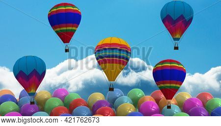 Composition of hot air balloons and rows of colourful balloons over clouds on blue background. celebration and party concept digitally generated image.