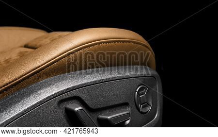 Modern Luxury Car Brown Leather And Alcantara Interior. Part Of Orange Perforated Leather Car Seat D