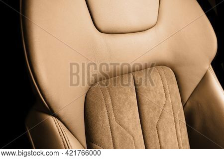 Modern Luxury Car Brown Leather With Alcantara Interior. Part Of Orange Leather Car Seat Details Wit