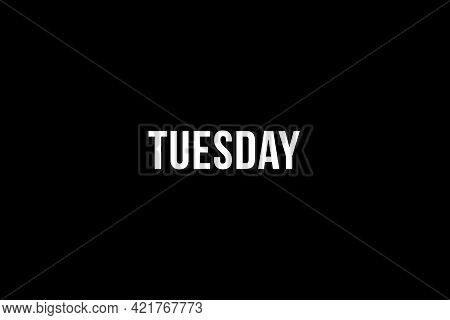 Tuesday. Day Of The Week. Weekly Calendar Day. White Letters Word Tuesday On Black Background, Poste