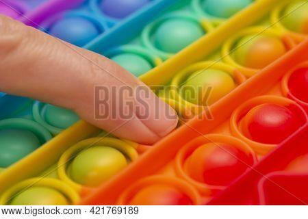 Close Up View On Pop It Antistress Game Fidget. Pop Fidget Sensory Toy For Autism Special Needs Stre