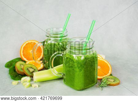 Green Smoothie In Glass Jar Made From Spinach, Celery, Orange, Apples. Detox Concept, Healthy Food,