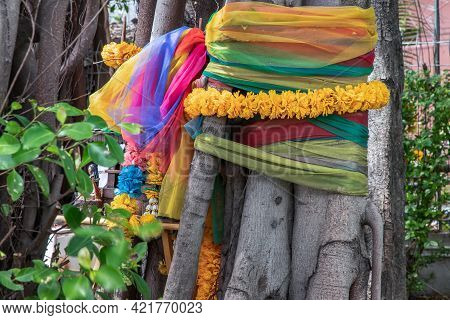 Marigold Flower Garlands And Fabric Colors Colorful Wrapped Around The Tree The Multicolored Cloth T