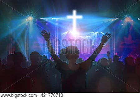 Christians Raising Their Hands In Praise And Worship At Cross Background