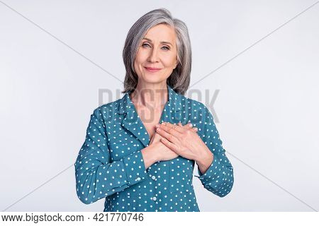 Photo Of Happy Smiling Peaceful Beautiful Businesswoman Hold Hands Chest Thankful Isolated On Grey C