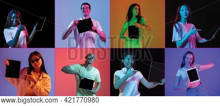 Group Of Young People Men And Women With Digital Tablets Isolated On Multicolored Background In Neon