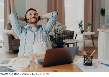 Young Relaxed Male Freelancer In Casual Clothes Dreaming About Weekend Or Vacation, Happy Guy Restin