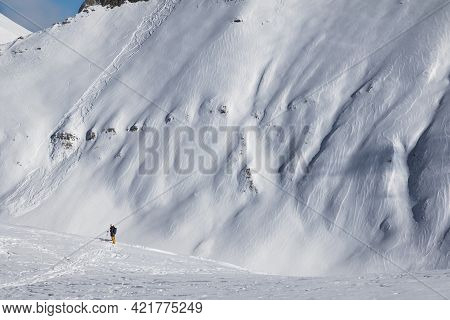 Skiers And Off-piste Slope With Traces Of Skis, Snowboards And Avalanches. Caucasus Mountains In Sun