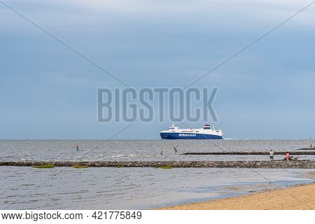 Cuxhaven, Germany - May 6, 2019: Cargo Ship Airbus On Board Passing Cuxhaven Beach Leaving Hamburg O