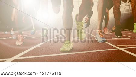 Composition of legs of running male athletes on racing track with spots of light. sport and competition concept digitally generated image.