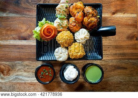 Top Down Flatlay Shot Of A Momo Platter With Crispy Tandoori Fried Momos Steamed Momos And Chicken P