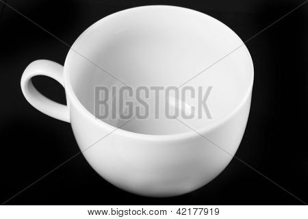 White Cup Isolated On Black Background