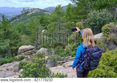 Woman Hiker From Behind Taking Picture Of Landscape With Mobile Phone. Female Trekker Photographing