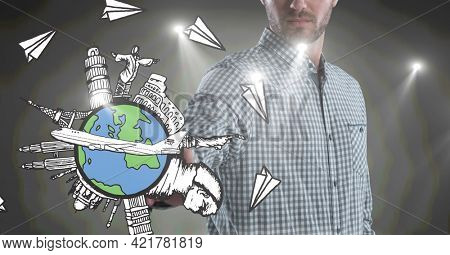 Midsection of caucasian man using digital interface with globe, famous sights and planes. global communication and travel interface concept, digitally generated image.