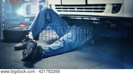 Composition of interactive screen with digital car drawing over car mechanic lying under car. car mechanic garage and technology concept digitally generated image