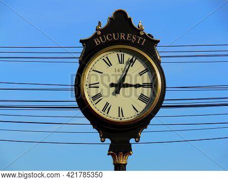 Vintage Style Black And Gold Metal Clock In Bucharest, Bucuresti. Romania.