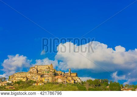 The Village Of Poggio Mirteto Seen From Below With A Clear Sky And Part Of The Surrounding Countrysi