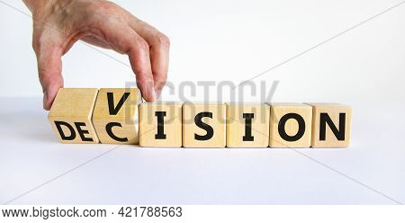 Vision And Decision Symbol. Businessman Turns Wooden Cubes And Changes The Word 'decision' To 'visio