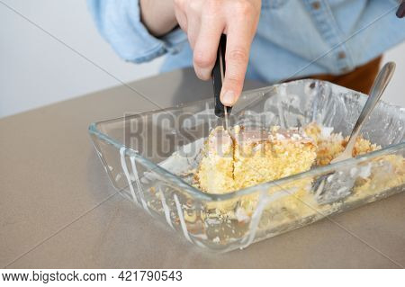 Close Up Of Woman Hand Cutting A Slice Of Homemade Pie.delicious Sweet Food.