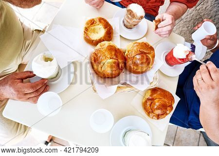 Different Types Of Granita With Brioche On A Coffee Table. Top View Of People Having Breakfast With