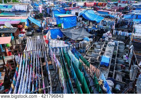 View of Dhobi Ghat (Mahalaxmi Dhobi Ghat) is world largest open air laundromat (lavoir) in Mumbai, India with laundry drying on ropes. Now one of signature landmarks and tourist attractions of Mumbai