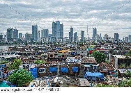 View of Mumbai skyline with skyscrapers over slums in Bandra suburb. Mumbai, Maharashtra, India