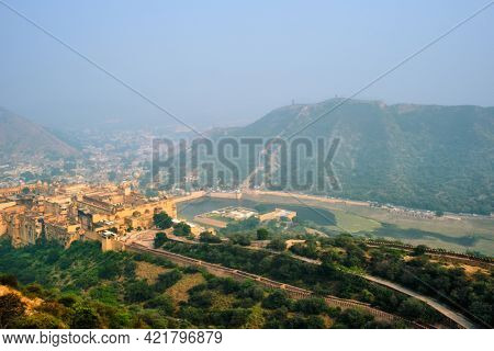 Indian travel famous tourist landmark - view of Amer (Amber) fort and Maota lake from Jaigarh Fort. Jaipur, Rajasthan, India